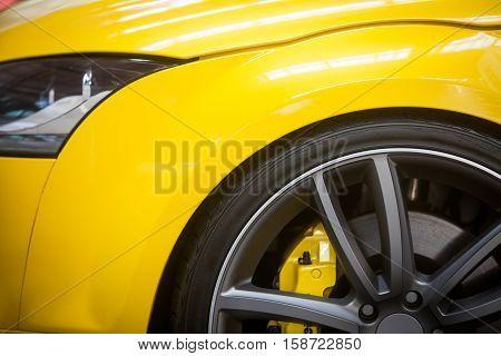 Close up shot of a yellow car rim.