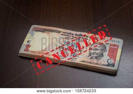 Old One thousand rupee indian currency notes with 'cancelled' stamp.