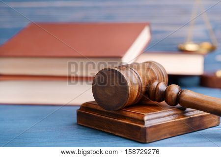 Gavel, books and scales, closeup