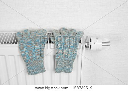Heating radiator with knitted  gloves