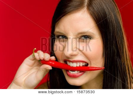 Chili Pepper - Portrait Young Woman Bite Red Spicy