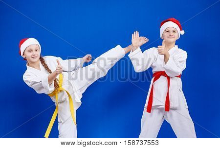 Cheerful athletes beat kick and point the finger super