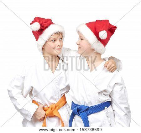 Sportsmen in karategi and Santa Claus caps