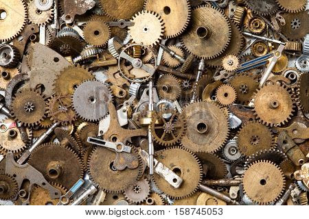 Steampunk mechanical equipment and mechanism background. Aged gears, hand clock parts. Shabby grunge scratch metal texture. Shallow depth of field