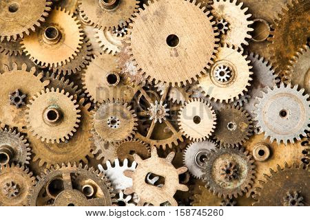 Vintage gears macro view. Aged mechanical clock wheels background. Shallow depth of field