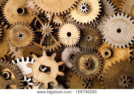 Steampunk gears background. Aged mechanical clock wheels close-up. Shallow depth of field