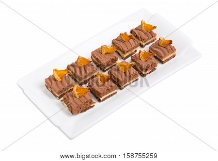 Delicious chocolate brownies with orange creme. Isolated on a white background.