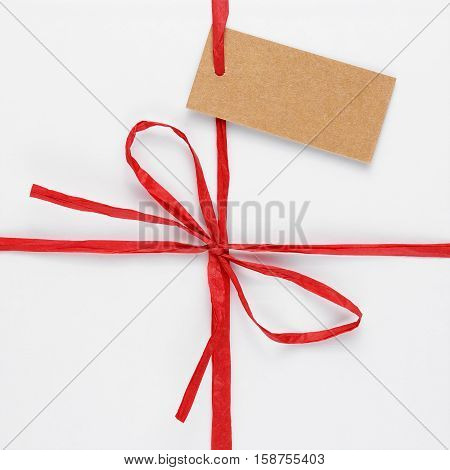 Top of white gift box with tag