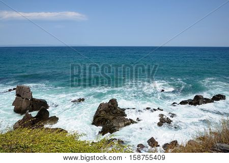 Seaside view with blue sky and turquoise sea