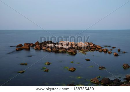 Evening calm sea and stones. Long exposure