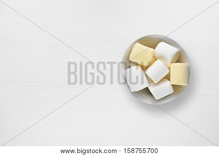 Marshmallow in bowl on white table top view