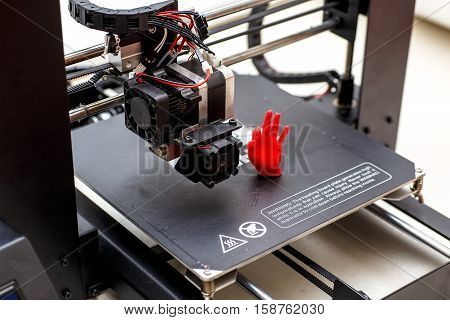 printed hand model. Plastic red. 3d printer at home