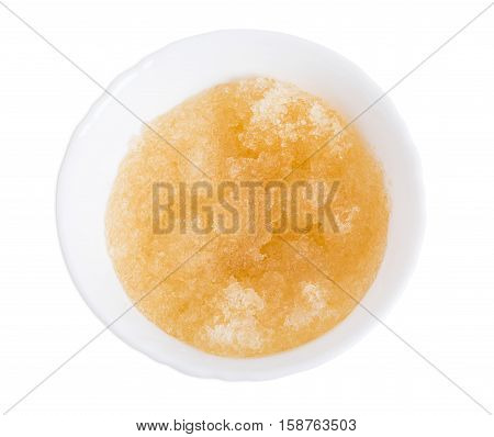 Gelatin in white bowl closeup. Isolated on a white background.