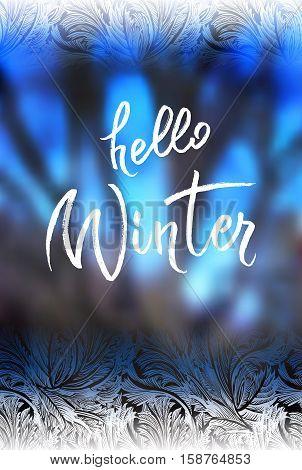 Hello winter brush lettering calligraphy at blue blur winter background with frost hoar border frame. Frozen glass design. Vector illustration stock vector.