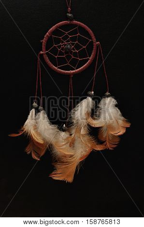 A dream catcher isolated on a black background