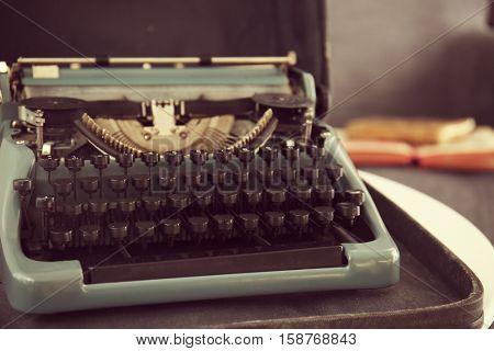 Vintage typewriter in case, close up view