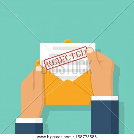 Open envelope in the hands of a businessman with letter printing