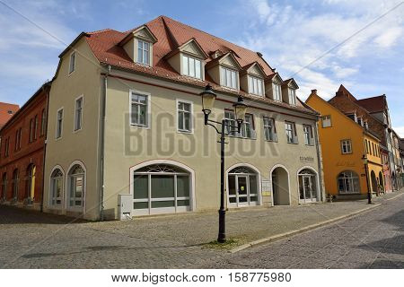 Naumburg, Germany - April 13, 2016. Street view on Marienstrasse street in Naumburg, with residential buildings, commercial properties and street lamps.