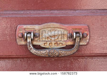 Ornate brass door knocker on door in Bolivia
