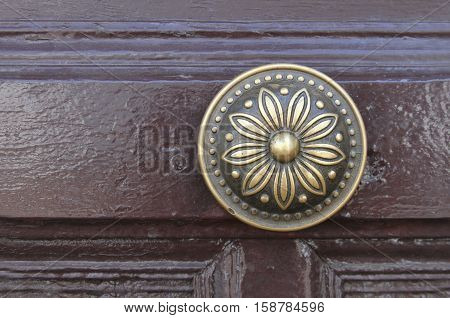 Ornate brass door knob on door in Bolivia