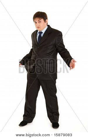 Full length portrait of surprised businessman turning empty pocket inside out. Concept - bankruptcy