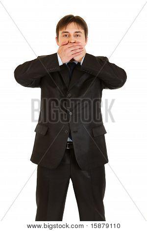 Modern businessman making speak no evil gesture isolated on white