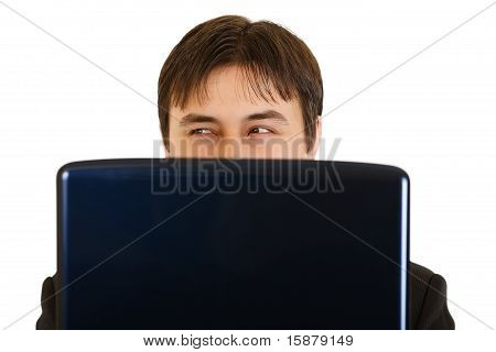 Modern businessman warily looking out from laptop isolated on white