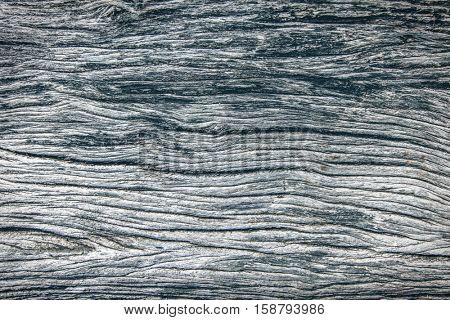 Pattern of old weathered gray wood close up
