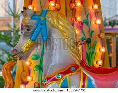 Colorful vintage carousel or merry-go-round horse closeup