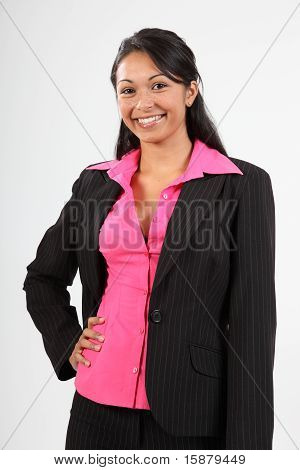 Beautiful young woman wearing dark business suit