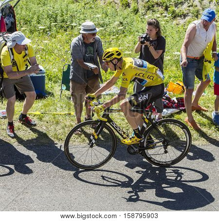Col du Grand ColombierFrance - July 17 2016: The British cyclist Christopher Froome in Yellow Jersey riding on the road to Col du Grand Colombier in Jura Mountains during the stage 15 of Tour de France 2016.