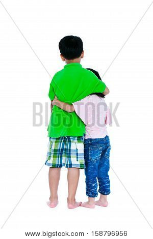 Back view of asian boy put one's arm around sister's shoulder isolated on white background. Girl putting her arm around her brother's waist. Concept about loving and bonding of sibling. Studio shot.