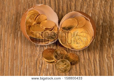 Pure Gold Coins In Egg Shell Illustrating Nest Egg