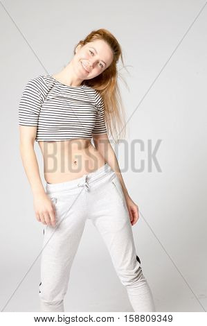 Girl In Sportswear Tilted Her Head To One Side Smiling