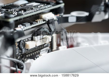 Big detail. Close up of a motor and chip as details of drone