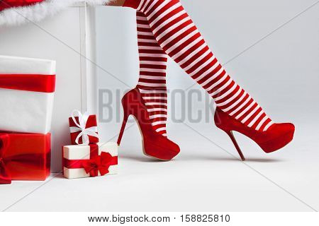 Santa woman legs and christmas gifts, Christmas shopping concept