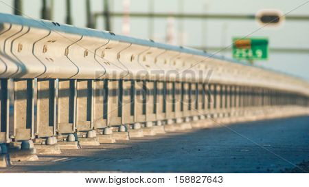 Guard rail or guardrail sometimes referred to as guide rail or railing is a system designed to keep people or vehicles from straying into dangerous or off-limits areas.