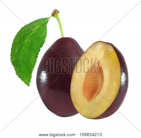 whole and cut plum with leaf isolated on white background with clipping path