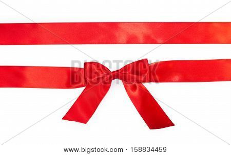 Red horizontal gift ribbons and luxurious bow isolated on white background