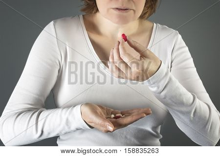 Close up of a woman taking the pill. Medicine health care concept.