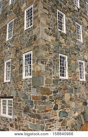 Corner stones of an 18th century factory showing twelve over twelve window panes.