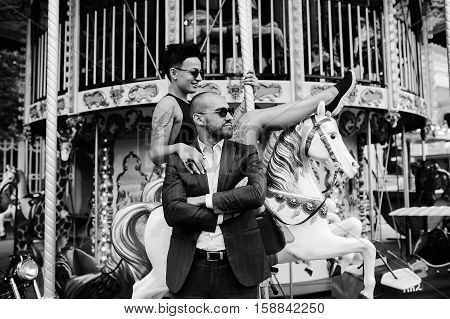 adult man and woman on merry go round carousel