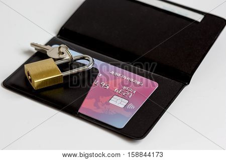 Credit cards with lock, card holder close up - online shopping on white background
