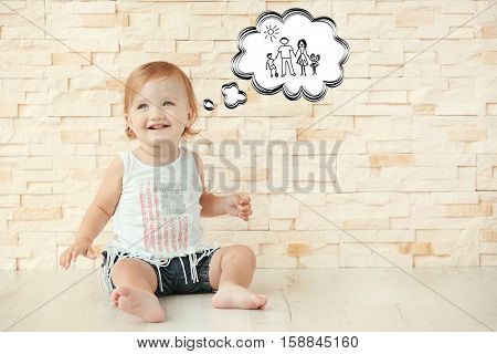 Cute little girl dreaming of happy family. Adoption, custody and childcare concept.