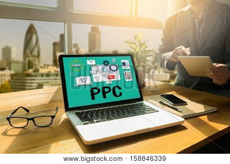 CPC cost per click concept Business team hands at work Pay per click - internet marketing advertising PPC OPTIMIZATION