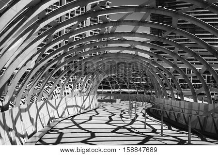 MELBOURNE, AUSTRALIA - OCTOBER 19, 2016: Webb Bridge is a pedestrian bridge over the Yarra River and a part of public art project in Melbourne Docklands area. In collaboration with artist Robert Owen
