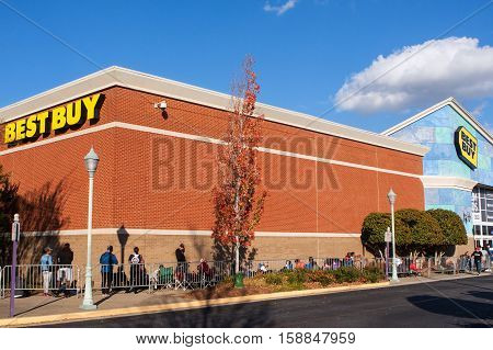 BUFORD, GA - NOVEMBER 2016: Customers wait in line behind a barrier on Thanksgiving day as they wait for Black Friday shopping to begin at Best Buy in Buford GA on November 24 2016