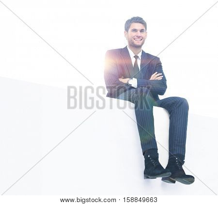 young business man sitting on a white top