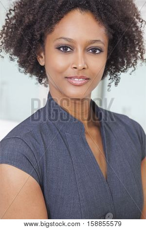 A beautiful mixed race African American young woman or businesswoman