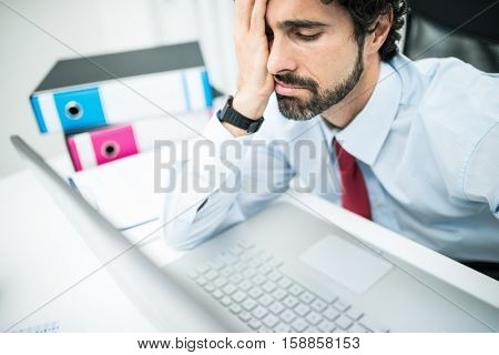 Tired and discouraged businessman portrait